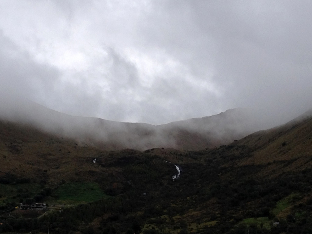 fog descenting over a dark mountain landscape